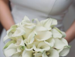 anonymous bride with bouquet of white tender flowers