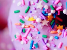 pink doughnut with colorful sprinkles